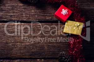 Christmas decoration and gift boxes on wooden table