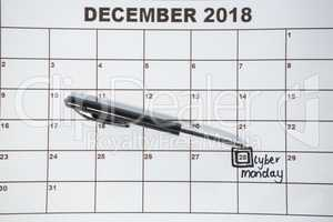 Pen on calender with marked date