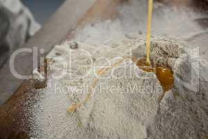 Liquid egg poured on flour