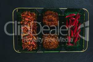 Dried red chili pepper, red chili and crushed red pepper in bowl
