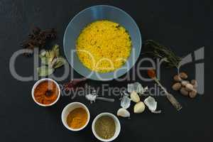 Rice in bowl with various spices and ingredients