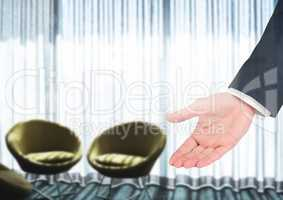 Hand inviting you to seats to sit down