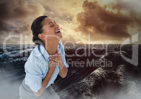 Businesswoman grieving in pain by ocean waves