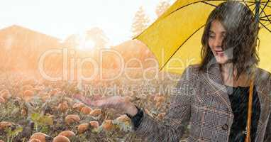 Woman in Autumn with apple in pumpkin field