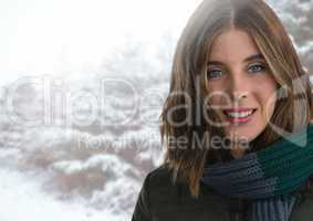 Woman wearing scarf in snow forest