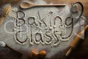 The word baking class written on sprinkled flour