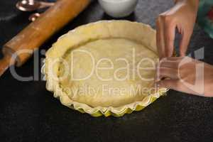 Woman pressing tart dough on mold