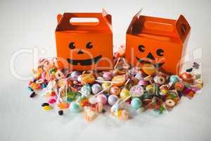 Orange boxes by various sweet food