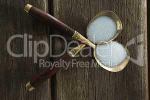 Salt in spoon on wooden table