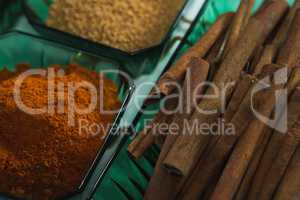 Cinnamon with spices powder in bowl