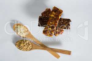 Cereal bars with cereals in spoon ready for breakfast