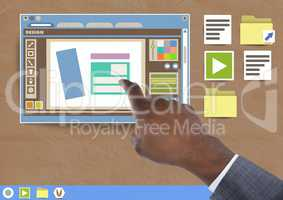 Hand touching Design editor window and Folder and files icons on Paper cut out desktop