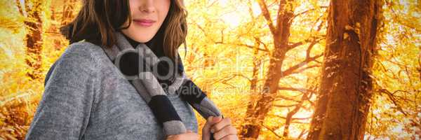 Composite image of portrait of young woman in scarf