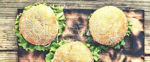 Rustic style, top view. Hamburger on a wooden table. Rustic
