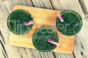 Detox drink made from spinach, cucumber, lime and avocado. DETOX drink made from green vegetables in a blender.