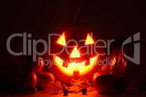 scary pumpkin head with glowing eyes - symbol of Halloween