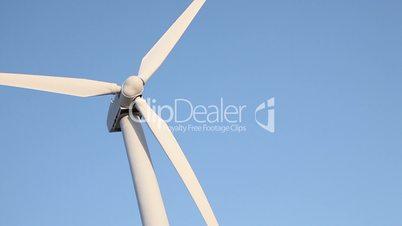 Wind Turbine Spinning In The Desert.
