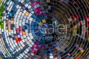 Colourful reflections in a disco ball.
