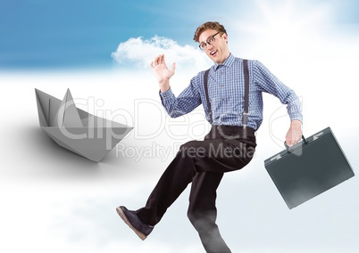 Businessman with briefcase and paper boat in sky