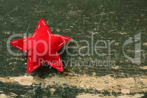 Close up of red star shape decoration