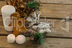 High angle view gingerbread cookie with star shape decorating and illuminated candles