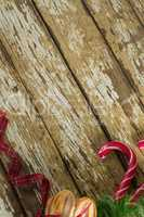Sweet food and christmas decorations on wooden plank
