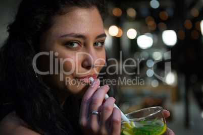 Portrait of beautiful woman drinking mocktail