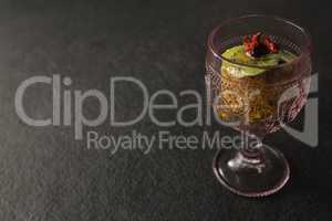 Dried fruits and granola bar in glass