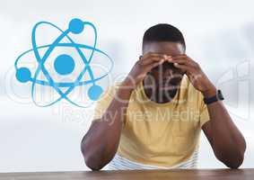 Businessman at desk with diagram of science atoms