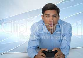Businessman playing with computer game controller with bright curves background