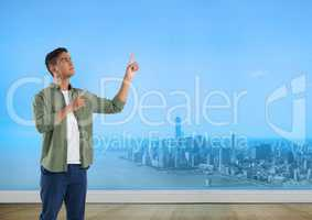 Businessman pointing to sky over city