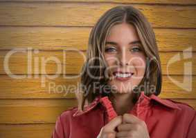 Woman against wood with jumper closed tight and warm