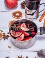 cooked mulled wine in an aluminum container