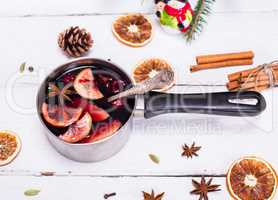 cooked mulled wine in an aluminum pan