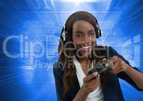 Businesswoman playing with computer game controller with blue motion background