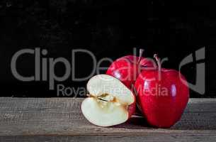 Whole and cut in half apple