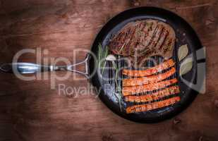 fried piece of beef on a round frying pan