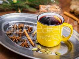 hot drink mulled wine in a yellow mug