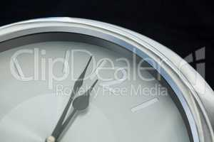 Clock hands reaching 12 clock midnight