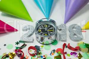 New year 2018 with alarm clock, decoration and party hat