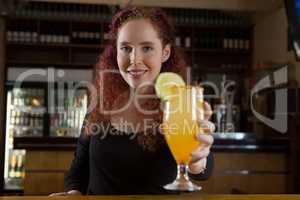 Beautiful waitress holding a drink