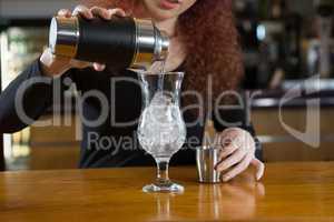 Waitress making a drink