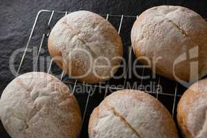 Dough balls with icing sugar on baking tray