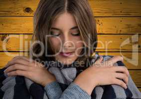 Woman against wood with warm scarf coat