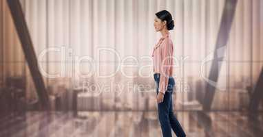 Businesswoman standing elegantly by soft light windows over city