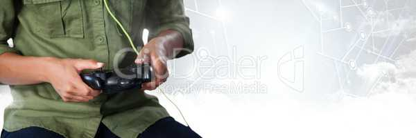 man playing with computer game controller with bright background