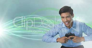 Businessman playing with computer game controller with curved lines background