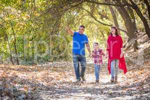 Mixed Race Caucasian and Hispanic Family Taking a Walk At The Pa