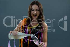 Woman pouring champagne into glass