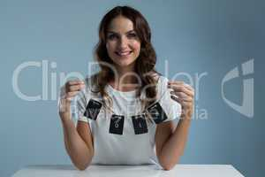 Smiling woman holding card of 2018 against white background